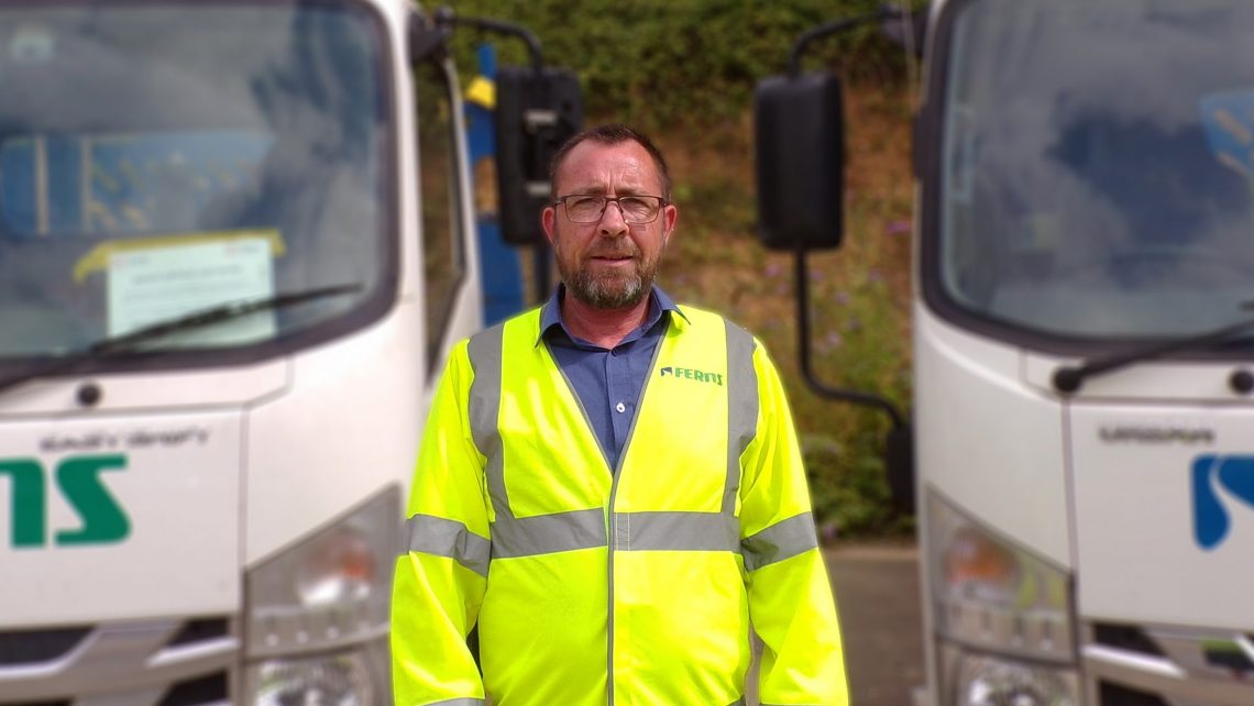 An image of Steve Reeves standing in front of 2 Ferns lorries, after we interviewed him about his role as the Contracts Director for Ferns Group.